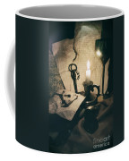Still Life With Bones Rusty Key Wine Glass Lit Candle And Papers Coffee Mug