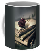Still Life With Books And Dry Red Rose Coffee Mug