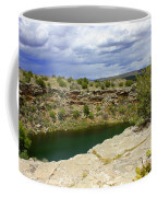 Storm Clouds Over Montezuma Well Coffee Mug
