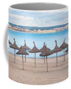 Straw Umbrellas On Empty Beach Coffee Mug