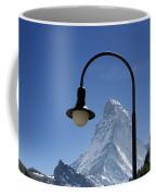 Street Lamp And Mountain Coffee Mug by Mats Silvan