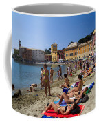 Sun Bathers In Sestri Levante In The Italian Riviera In Liguria Italy Coffee Mug