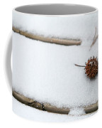 Sweetgum Seed Pod In The Snow Coffee Mug