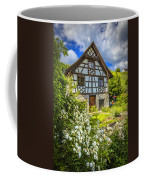 Swiss Chalet In The Garden Coffee Mug by Debra and Dave Vanderlaan