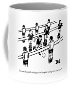 Table Soccer Players Look At One Unattached Coffee Mug