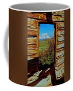Tetons Through Log House Window Coffee Mug