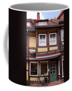 The Bike By The Door Coffee Mug
