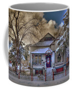 The Decorated Little House In The Snow Coffee Mug