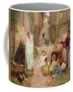 The Puppet Show Coffee Mug