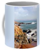 The Rocky Coastline Meets The Ocean Coffee Mug