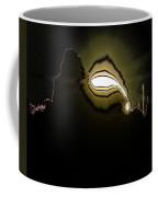 The Sun Over A Jagged Hill Coffee Mug