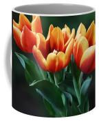 Three Orange And Red Tulips Coffee Mug