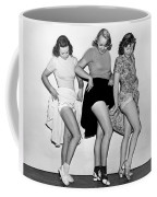 Three Women Lift Their Skirts Coffee Mug by Underwood Archives