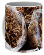 Top View Of Three Clear Bags Of Dried Coffee Mug