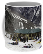 Tourists Surrounded By Snow And Ice Outside One Of The Few Buildings Coffee Mug