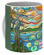 Tree And Lilies At Sunrise Coffee Mug