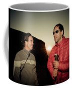 Two Men Share Stories As The Sun Sets Coffee Mug