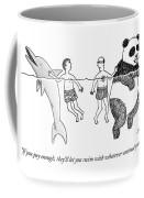 Two Men Swim In The Ocean.  One Man Swims Coffee Mug