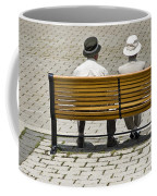 Two People Seated On A Bench Coffee Mug