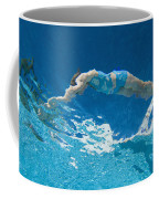 Underwater View Of Woman Diving Into Coffee Mug