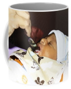 Using A Spoon To Feed A 4 Day Old Indian Baby Boy With Milk Coffee Mug