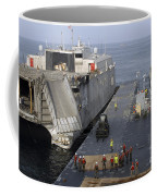 Vehicles Are Transferred Aboard Coffee Mug