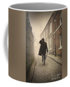 Victorian Man Running On A Cobbled Road Coffee Mug