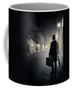 Victorian Man With Top Hat Carrying A Suitcase Walking In The Old Town At Night Coffee Mug