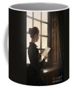 Victorian Or Edwardian Woman Reading A Letter By The Window Coffee Mug