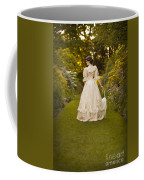 Victorian Woman In A Formal Garden Coffee Mug