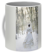 Victorian Woman Running Through A Winter Woodland With Fallen Sn Coffee Mug