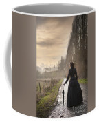 Victorian Woman Walking On A Cobbled Avenue At Sunset Coffee Mug