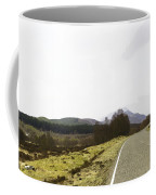 View Of Highway Running Through The Wilderness Of The Scottish Highlands Coffee Mug