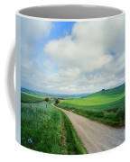 View Of Road Passing Through A Field Coffee Mug