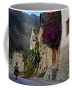 Woman Walking In Ollantaytambo In Peru Coffee Mug