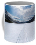 Well Used Winter Trail On Frozen Mountain Lake Coffee Mug