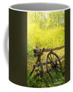 Wheel On Fence Coffee Mug