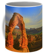 Whispy Clouds Over Delicate Arch Coffee Mug