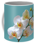 White Orchids On Ocean Blue Coffee Mug