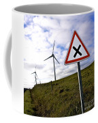 Wind Turbines On The Edge Of A Field With A Road Sign In Foreground. Coffee Mug