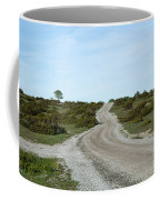 Winding Gravel Road Through A Landscape With Lots Of Junipers Coffee Mug