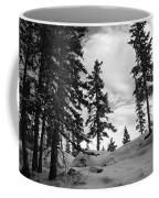 Winter Pines Silhouetted Against The Sky Coffee Mug by Cascade Colors