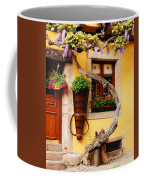 Wisteria And Yellow Wall In Alsace France Coffee Mug