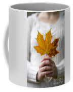 Woman Holding An Autumn Leaf Coffee Mug
