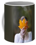 Woman Holding An Autumnal Leaf Coffee Mug
