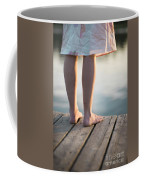 Woman In A Dress On The Edge Of A Wooden Board Walk Coffee Mug