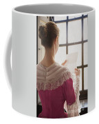 Woman In Historical Costume Reading A Letter By The Window Coffee Mug