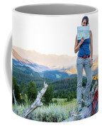 Woman Shows Off Her Mountain Drawing Coffee Mug