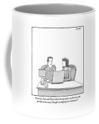 Woman Speaks To Husband As They Sit Behind A Desk Coffee Mug