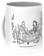 Woman Speaks To Man As They Do Bills At A Table Coffee Mug by Robert Leighton